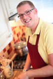 A Handsome Cook in the Kitchen Stock Photography