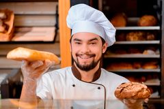 Handsome cook in the kitchen Stock Photo