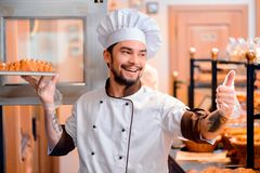 Handsome cook in the kitchen Stock Photography