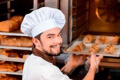 Handsome cook in the kitchen Royalty Free Stock Photos