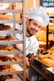 Handsome cook in the kitchen Royalty Free Stock Image