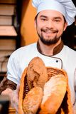 Handsome cook in the kitchen Royalty Free Stock Photography