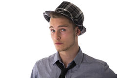 Handsome, cool, confident young man wearing fedora hat Stock Image