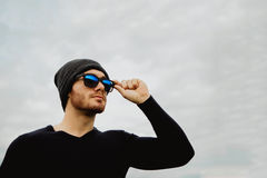 Handsome cool young man with sunglasses Royalty Free Stock Image