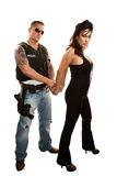 Handsome cop arresting pretty Latina woman Royalty Free Stock Images