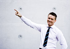Handsome Corporate Man Pointing Up Stock Photography