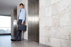 Handsome Corporate Manager Standing Near Lift Stock Photos
