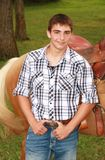 Handsome Country Boy and Palomino. Portrait of a young man with a  Palomino horse Stock Photography