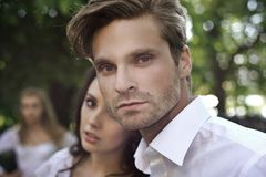 Handsome couple. Portrait of Handsome couple with nice girl stock photo