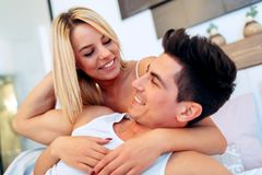 Handsome couple in bed being sensual Stock Images