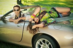 Handsome couple in cabriolet. Have fun Royalty Free Stock Photos