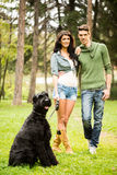 Handsome Couple With Dog Royalty Free Stock Photos