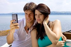 Handsome couple having fun taking selfie in vacation in Italy Royalty Free Stock Images