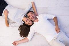 Handsome couple lying on floor Stock Photo