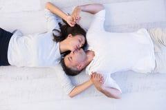 Handsome couple lying on floor Royalty Free Stock Photo