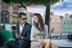 Handsome couple with mobile stock photography