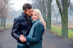 Handsome couple in the park. Handsome couple hugging in the park Stock Photos