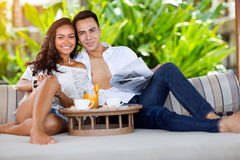 Handsome couple in tropical resort. Portrait of beautiful handsome couple in tropical resort Stock Image