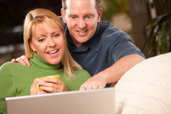 Handsome Couple Using Laptop Royalty Free Stock Photography