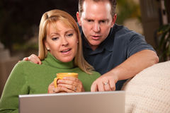 Handsome Couple Using Laptop Stock Images
