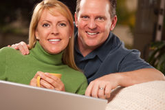 Handsome Couple Using Laptop Stock Image