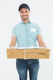 Handsome courier man with parcel Royalty Free Stock Photography