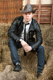 Handsome cowboy in leather jacket Stock Image