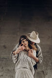 Handsome cowboy man in white hat touching cheek of beautiful boh Royalty Free Stock Image