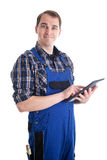 Handsome craftsman with digital tablet Royalty Free Stock Photos