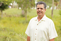 Handsome Cuban man in a tropical park Royalty Free Stock Images