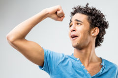 Handsome curly young man exulting Stock Image