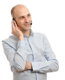 Handsome customer service operator. Wearing a headset isolated on white background Royalty Free Stock Photography