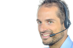 Handsome customer service operator wearing a headset Stock Photo