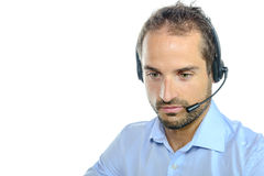 Handsome customer service operator wearing a headset Royalty Free Stock Photography