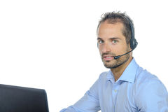 Handsome customer service operator wearing a headset. On white background Stock Images