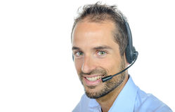 Handsome customer service operator wearing a headset. On white background Stock Photography