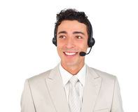 Handsome customer service representative using hea. Dset against a white background Royalty Free Stock Image