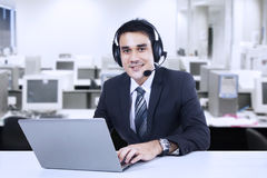 Handsome customer support Stock Images
