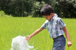 Handsome,cute indian kid playing with water spring Stock Images