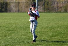 Handsome cute Young boy playing baseball waiting and protecting the base. Royalty Free Stock Photos