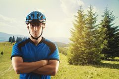 Cyclist portrait on a background of a picturesque mountain landscape Stock Images