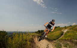 Handsome cyclist rides bike in the mountains Royalty Free Stock Photography