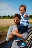 Handsome Dad Carrying His Little Son Stock Photography