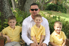Handsome dad with happy boys royalty free stock photos