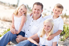 Handsome Dad and His Cute Children at The Beach Stock Photography