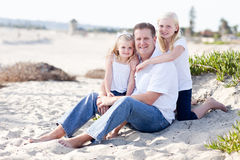Handsome Dad and His Cute Daughters at The Beach Stock Photo