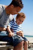 Handsome Dad with Son on the Beach Royalty Free Stock Photos