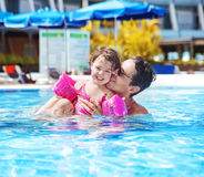 Handsome dad swimming with a cute daughter Royalty Free Stock Image