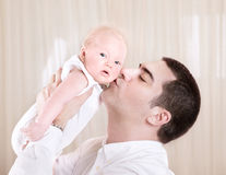 Handsome daddy kissing daughter Stock Image