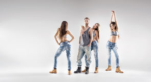 Handsome dancer with pretty ladies Stock Photos